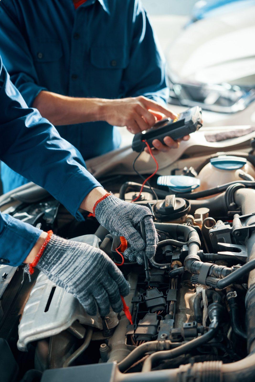 Mechanics testing car motor